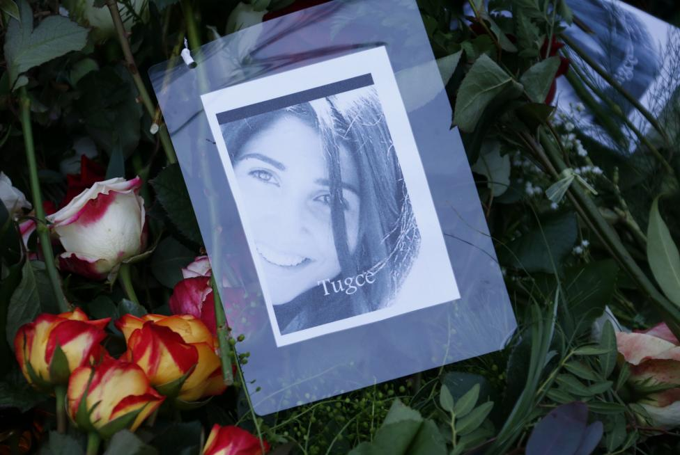 A photograph of Tugce Albayrak is placed among flowers on her grave at a cemetery in Bad Soden-Salmuenster