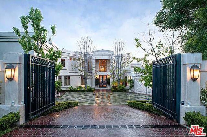 the-gated-home-is-in-hollywood-hills-west-and-has-9696-square-feet-with-a-wine-cellar-library-and-guest-house