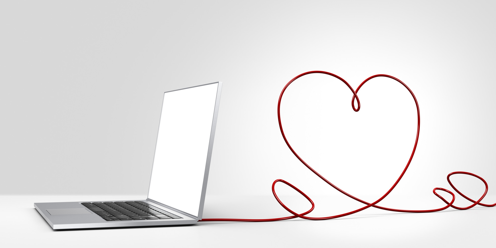 Laptop computer with cable forming a heart