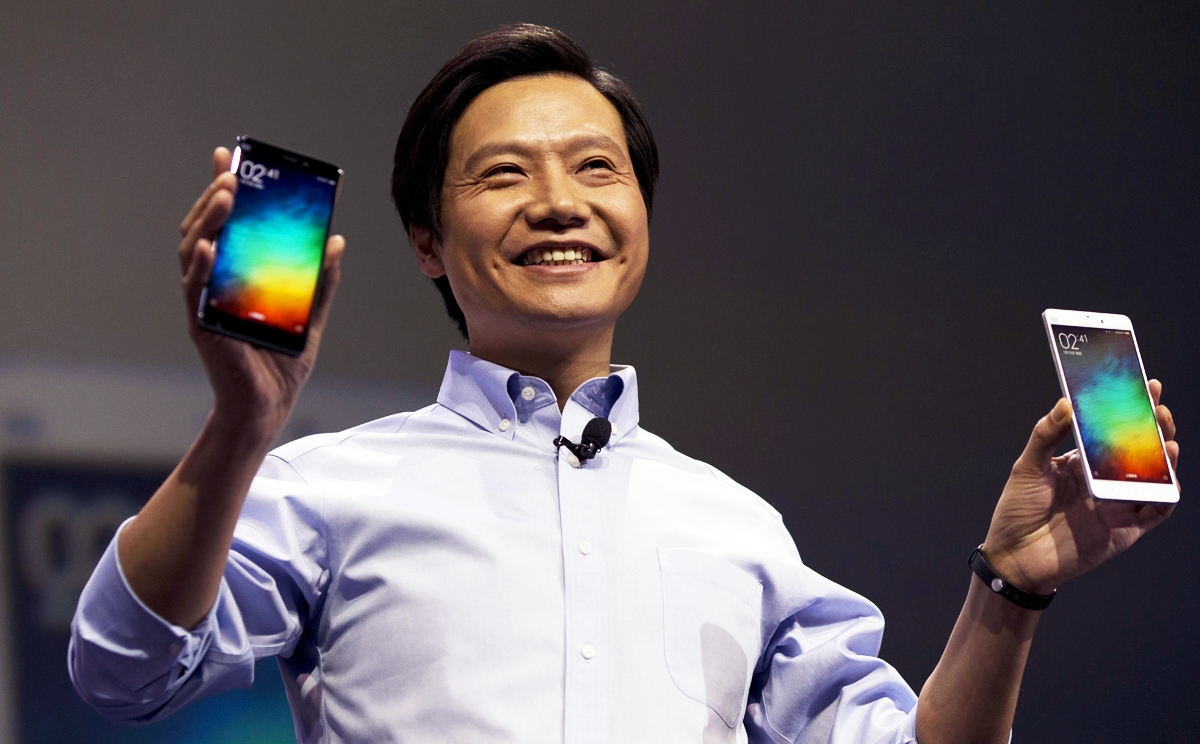 Lei Jun, chairman of Chinese smartphone maker Xiaomi, holds up the latest models of the Xiaomi Note at a press event in Beijing, Thursday, Jan. 15, 2015. The Chinese manufacturer on Thursday unveiled a new model that Lei said has processor size and performance comparable to Appleís iPhone 6 but is thinner and lighter. (AP Photo/Ng Han Guan)