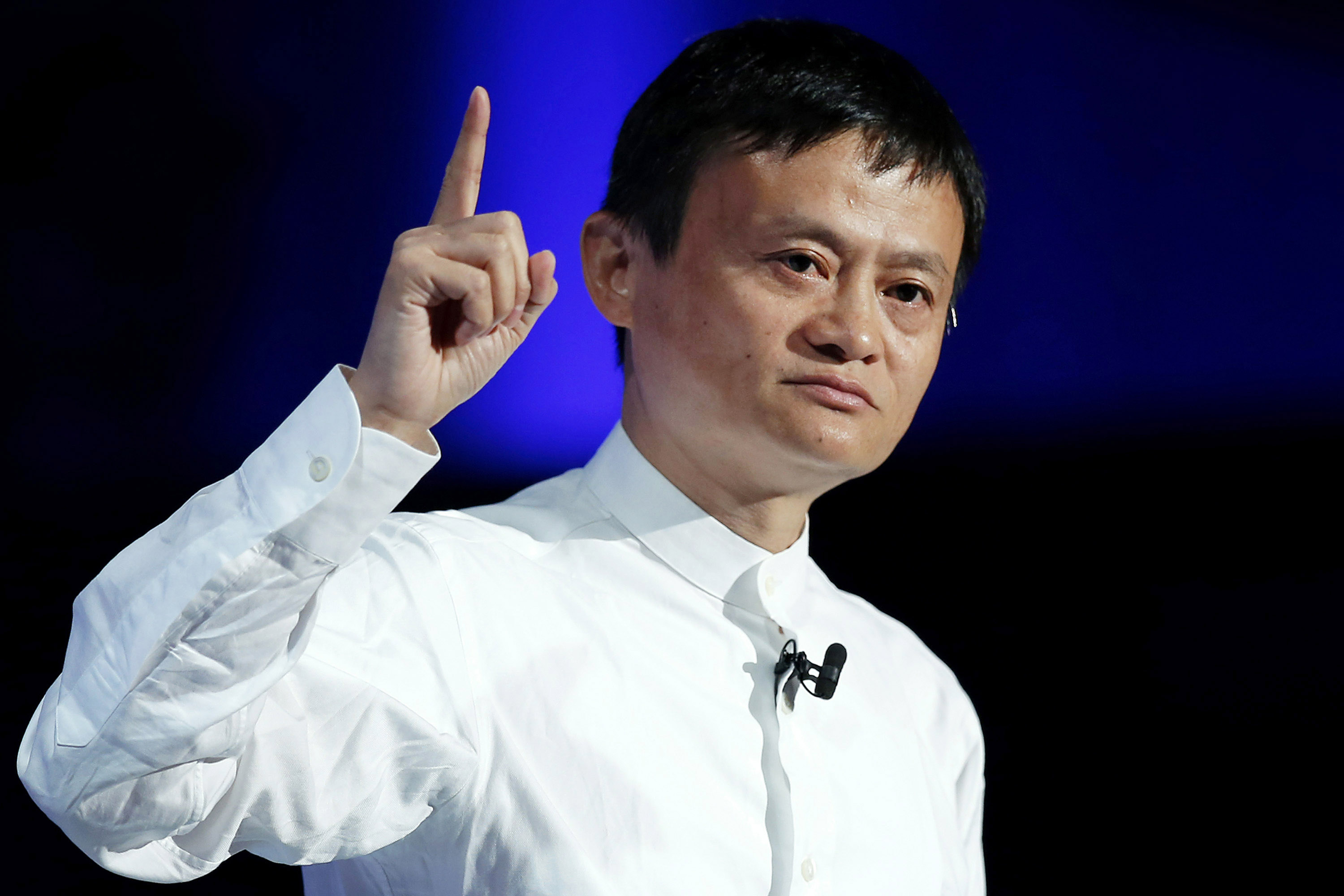 Jack Ma, chairman of Alibaba Group Holding Ltd., gestures as he speaks at SoftBank World 2014 in Tokyo, Japan, on Tuesday, July 15, 2014. As SoftBank Corp. Chief Executive Officer Masayoshi Son pushes for a takeover of T-Mobile US Inc., the Japanese billionaire is asking banks to commit financing for a longer-than-usual amount of time, underscoring the intense regulatory review he faces. Photographer: Kiyoshi Ota/Bloomberg *** Local Caption *** Jack Ma