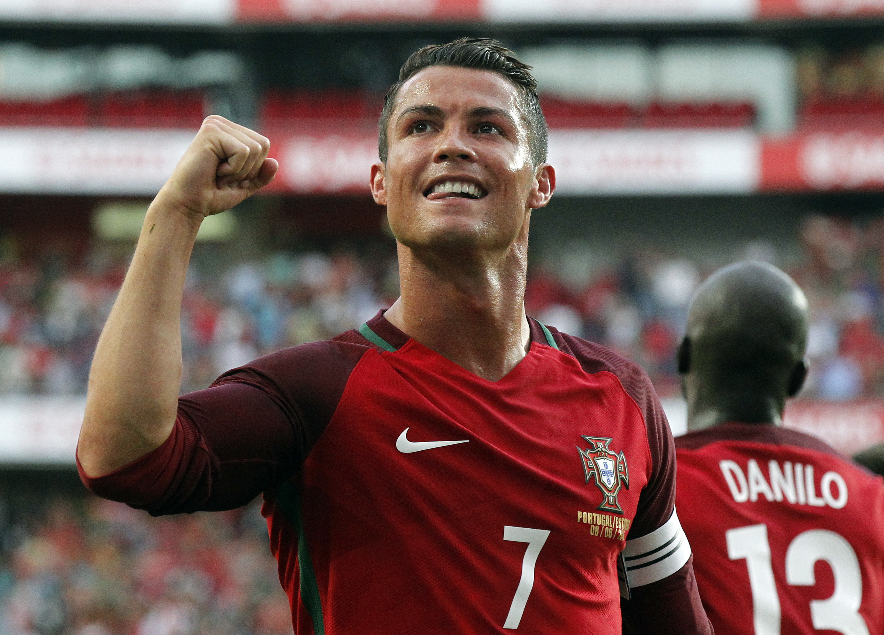 Portugal's Cristiano Ronaldo celebrates after scoring against Estonia during their friendly soccer match at Benfica stadium in Lisbon, Wednesday, June 8 2016. Portugal will play in the Euro2016 in Group stage against Austria, Hungary and Iceland in Group F. (AP Photo/Steven Governo)