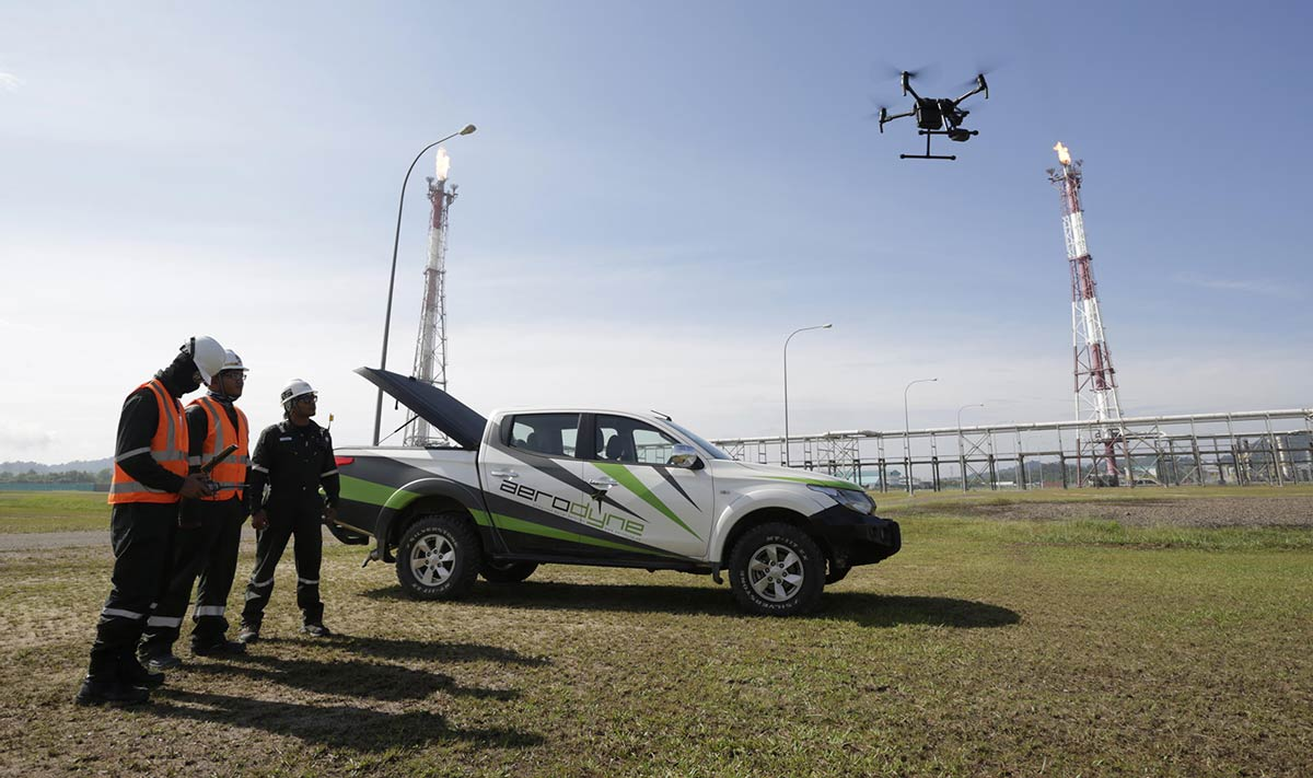 Aerodyne-staff-operating-a-drone-for-infrastructure-inspection