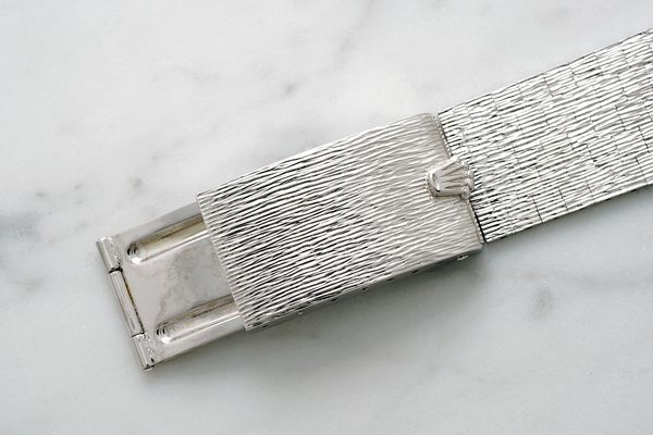 the-watch-comes-with-a-white-gold-bracelet-with-bark-finish-which-was-added-by-its-current-owner-fol_s600x0_q80_noupscale