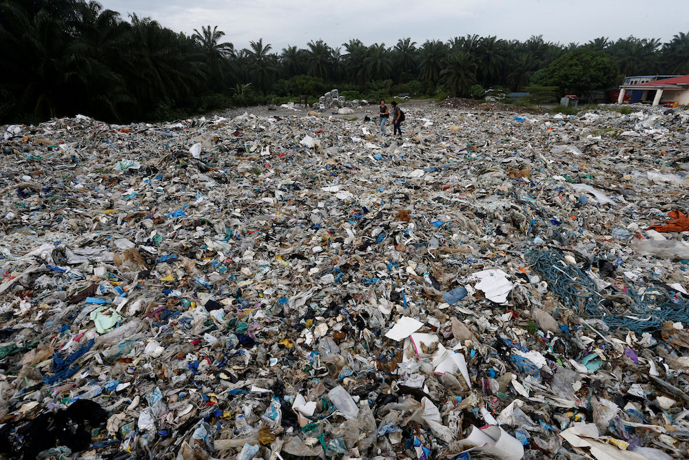 Plastic waste are piled outside an illegal recycling factory in Jenjarom, Kuala Langat