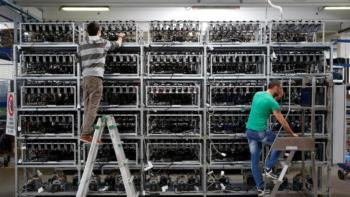 Employees-work-on-bitcoin-mining-computers-at-Bitminer-Factory-in-Florence