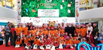 Photo 1 – Group Photo of underprivileged children accompanied by Senior Management of Quill City Mall KL and emcees