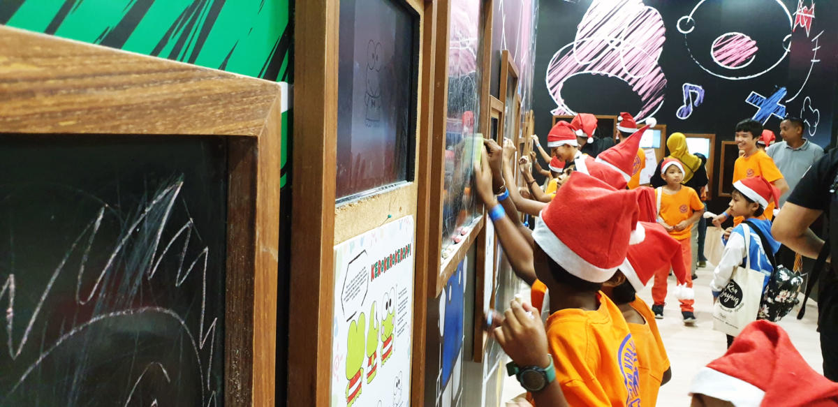 Photo 4 – Underprivileged children participating in a drawing and colouring activity in Our Sanrio Times Exhibition