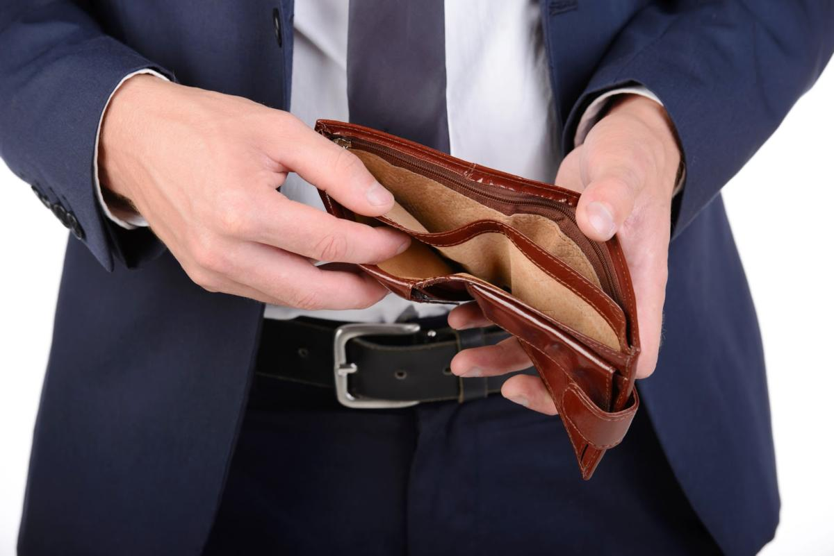 30783279 – businessman well-dressed with empty wallet, no money