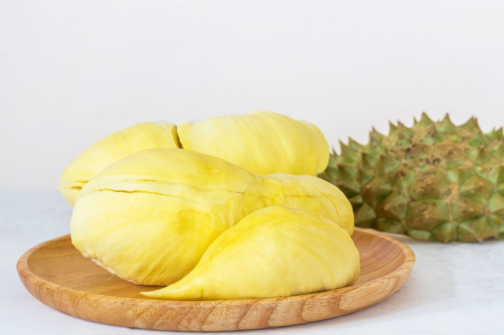 Durian in a wooden dish, durian is the king of fruit, the bark is sharp spiny, strong smell, sweet taste.