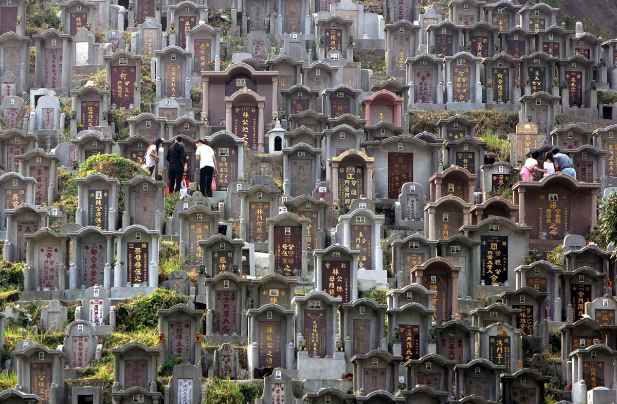 Worshippers clean the graves of their ancestors at a cemetery in Hong Kong.