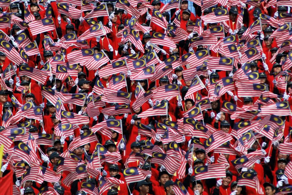 Malaysians-Waves-Their-National-Flags-During-Malaysia-Day-Celebration-1024×685