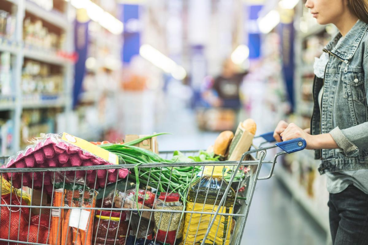 woman-pushing-shopping-cart-full-of-food_gettyimages-979976694