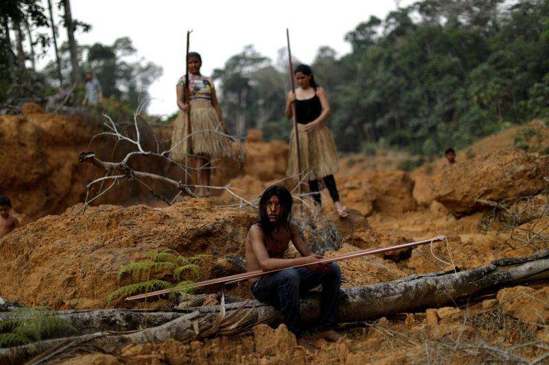 FILE PHOTO: Indigenous people from the Mura tribe show a deforested area in unmarked indigenous lands, inside the Amazon rainforest near Humaita