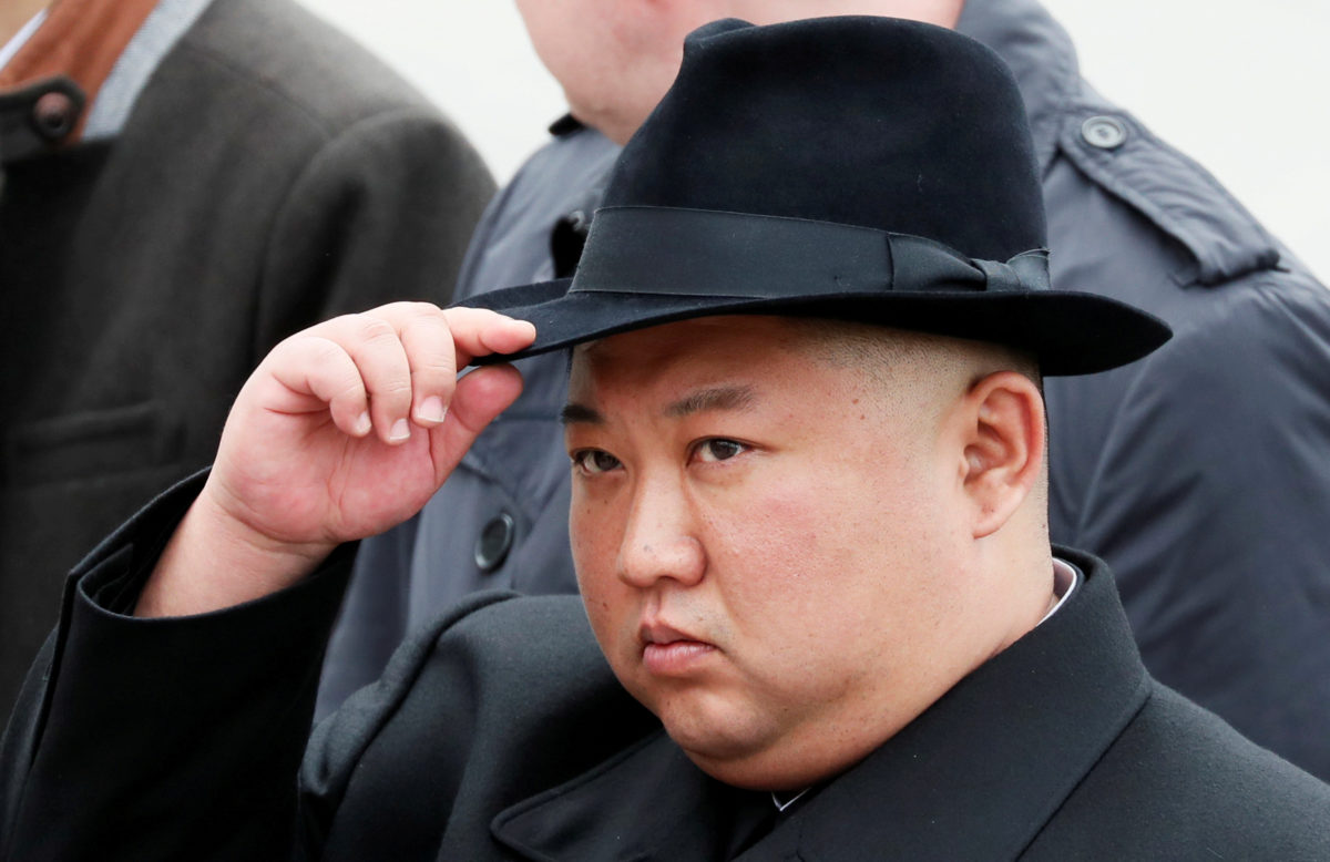 FILE PHOTO: North Korean leader Kim Jong Un attends a wreath laying ceremony at a navy memorial in Vladivostok