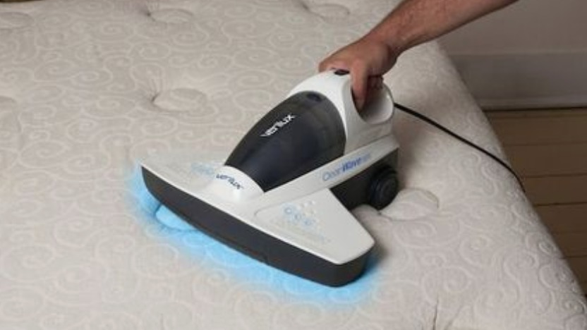 using-uv-dust-mite-vacuum-cleaner-on-bed