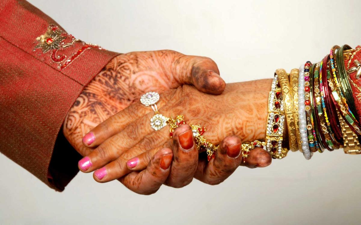 Bride and bridegroom holding hand