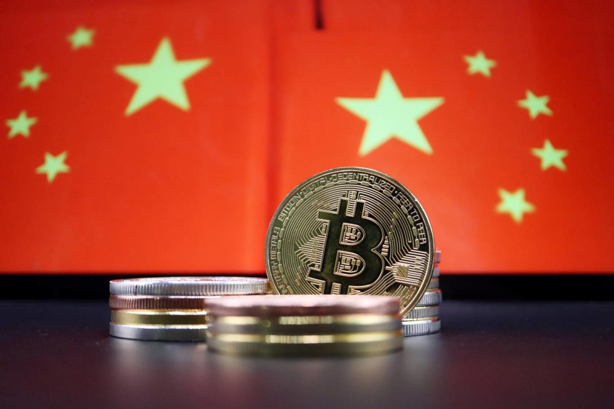 Illustration picture of China flags and Bitcoin cryptocurrency